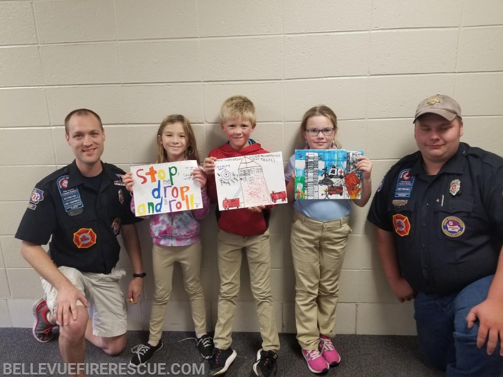 (Left to Right) Firefighter Mike Sturm, St. Joseph's Elementary 1st place Adleigh Kettmann, 2nd place Brayden Peterson, 3rd place Autumn Ludwig, Firefighter Hunter Zeimet