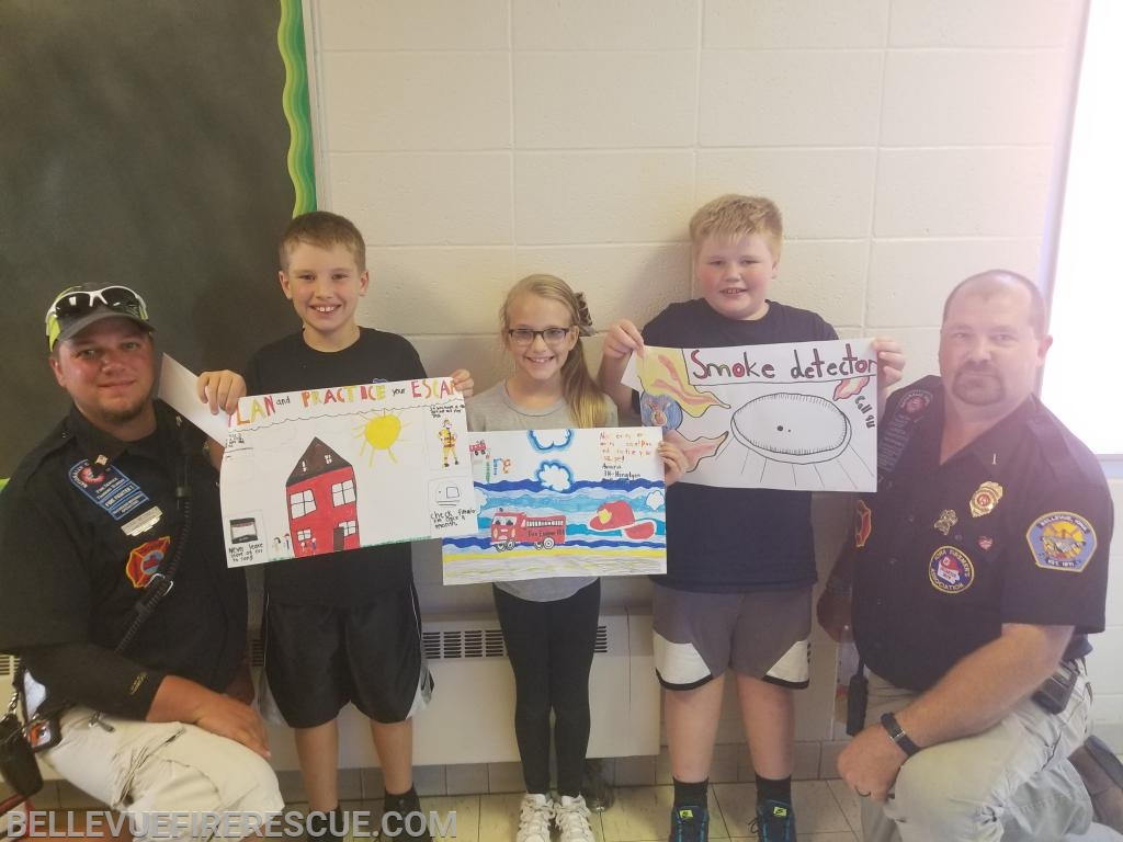 (Left to Right) Firefighter Brian Medinger, Bellevue Elementary 1st place Cash Kirk, 2nd place Aviana Herrig, 3rd place Tayden Kilburg, Lieutenant Chris Smith